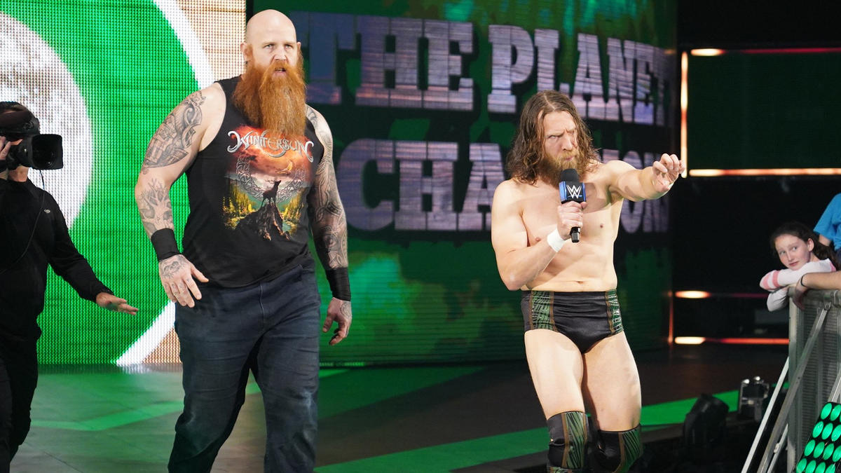 Daniel Bryan & Rowan hit the scene... but they leave without saying anything.