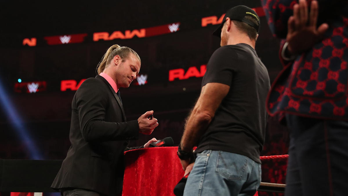 Dolph signs the contract.