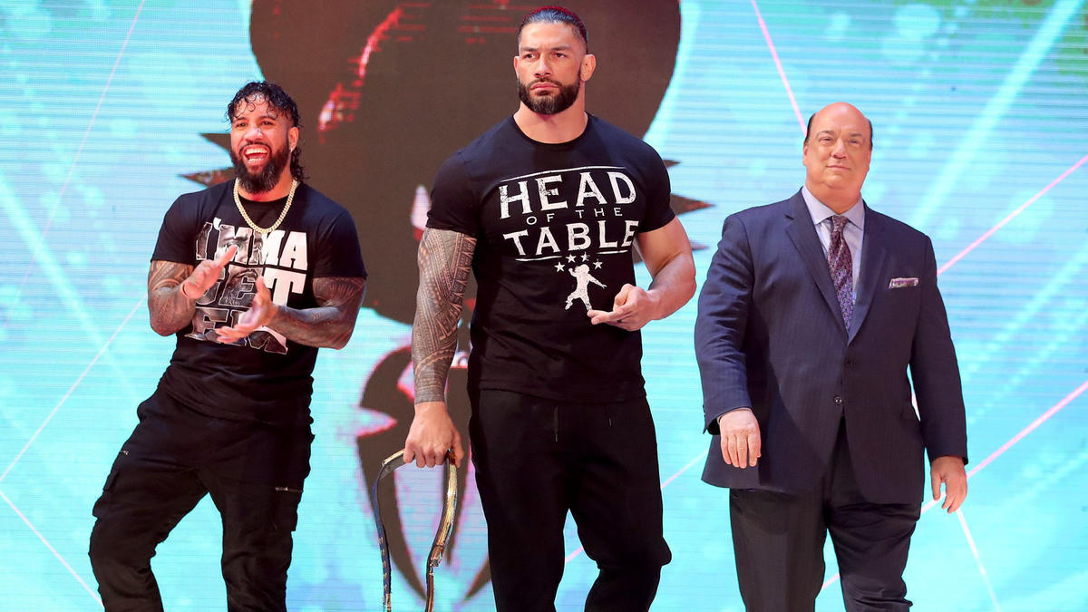 Roman Reigns, Jey Uso and Paul Heyman.