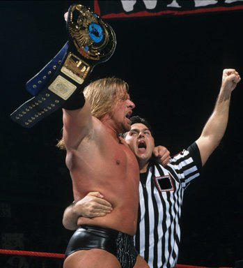 The 13 Reigns of Triple H: Photos | WWE
