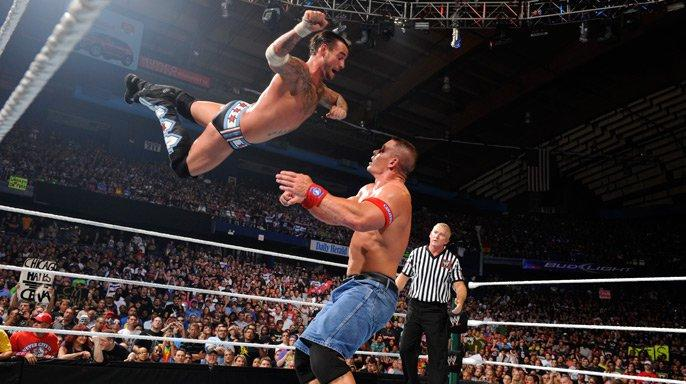 Cena battles not only a fiercely determined Punk, but a hostile crowd as well.