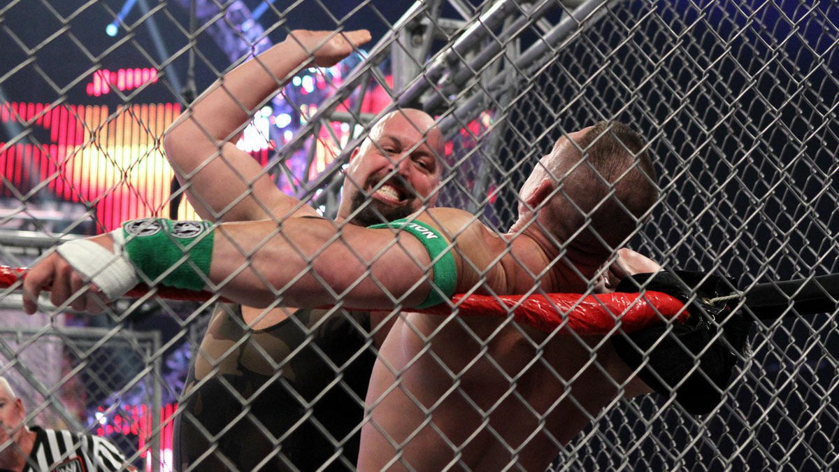 A hefty chop from Big Show to Cena's chest puts Cena on the ropes.