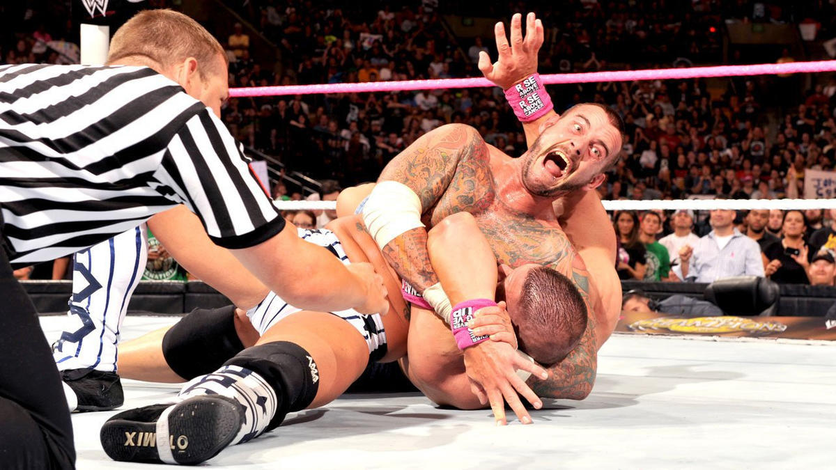 After Punk avoids Cena's Five Knuckle Shuffle, he locks in the Anaconda Vise.