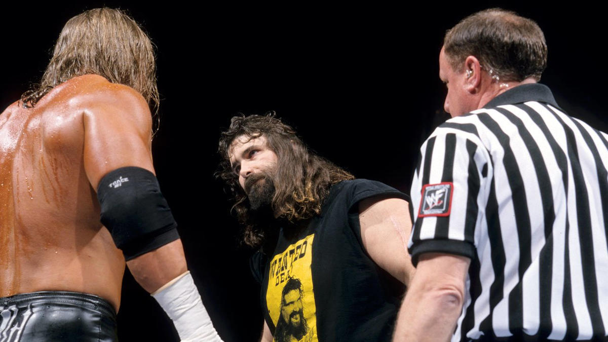 At the outset of their brutal WWE Title Street Fight, Cactus Jack stared a hole through Triple H.