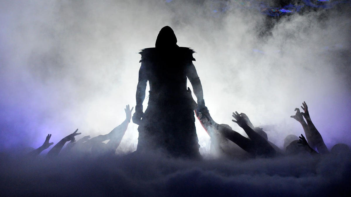 The Undertaker walking past undead hands at WM 29