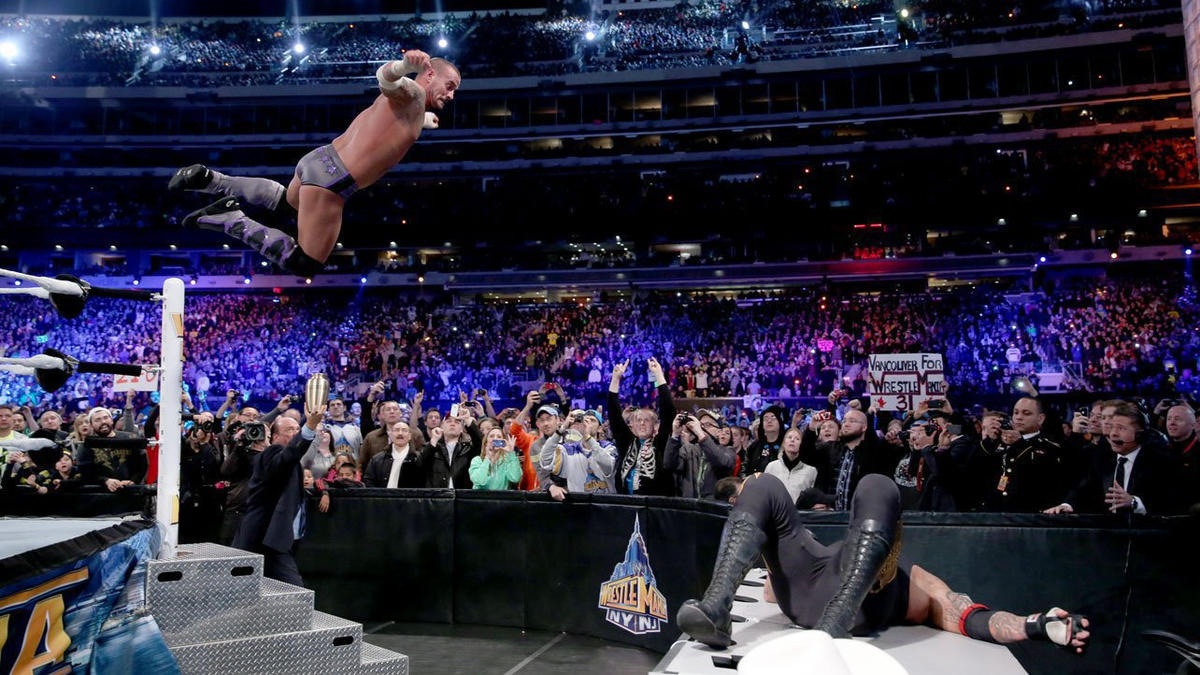 The Chicago native splays The Undertaker across a ringside table and blasts him with a searing elbow drop from the turnbuckle.