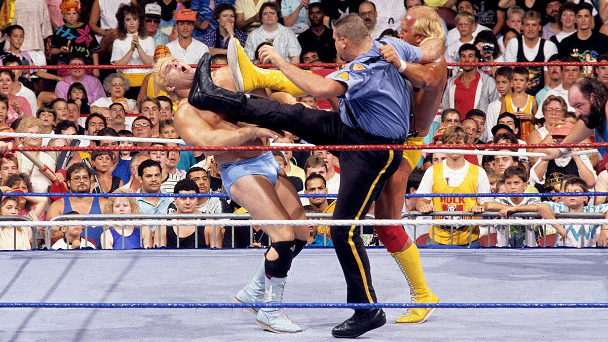 Hulk Hogan got help from Big Boss Man in fending off Dino Bravo during a contest against Earthquake.
