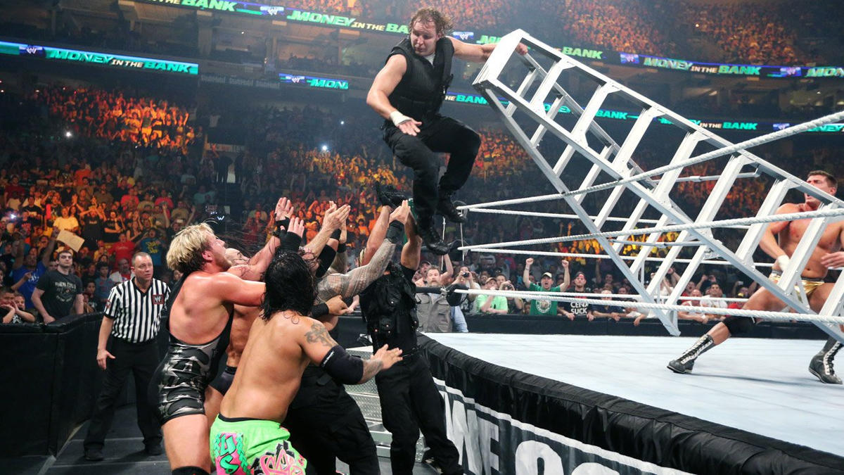 After The Shield and The Usos interfere, Ambrose is sent hurtling to the cadre of Superstars many feet below at ringside.