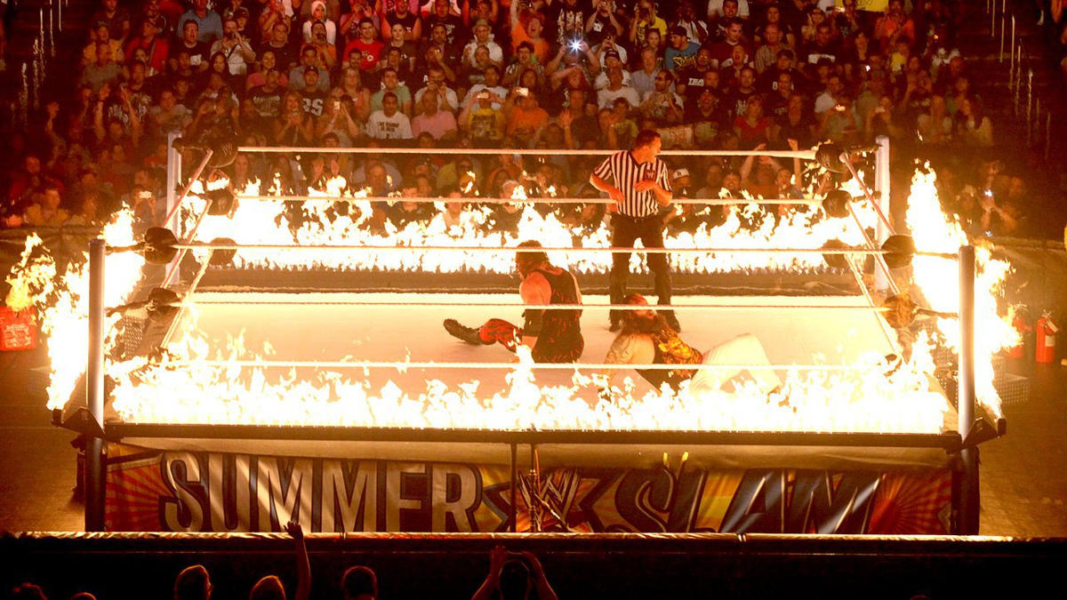 Flames shoot up around the ropes with each impactful maneuver.