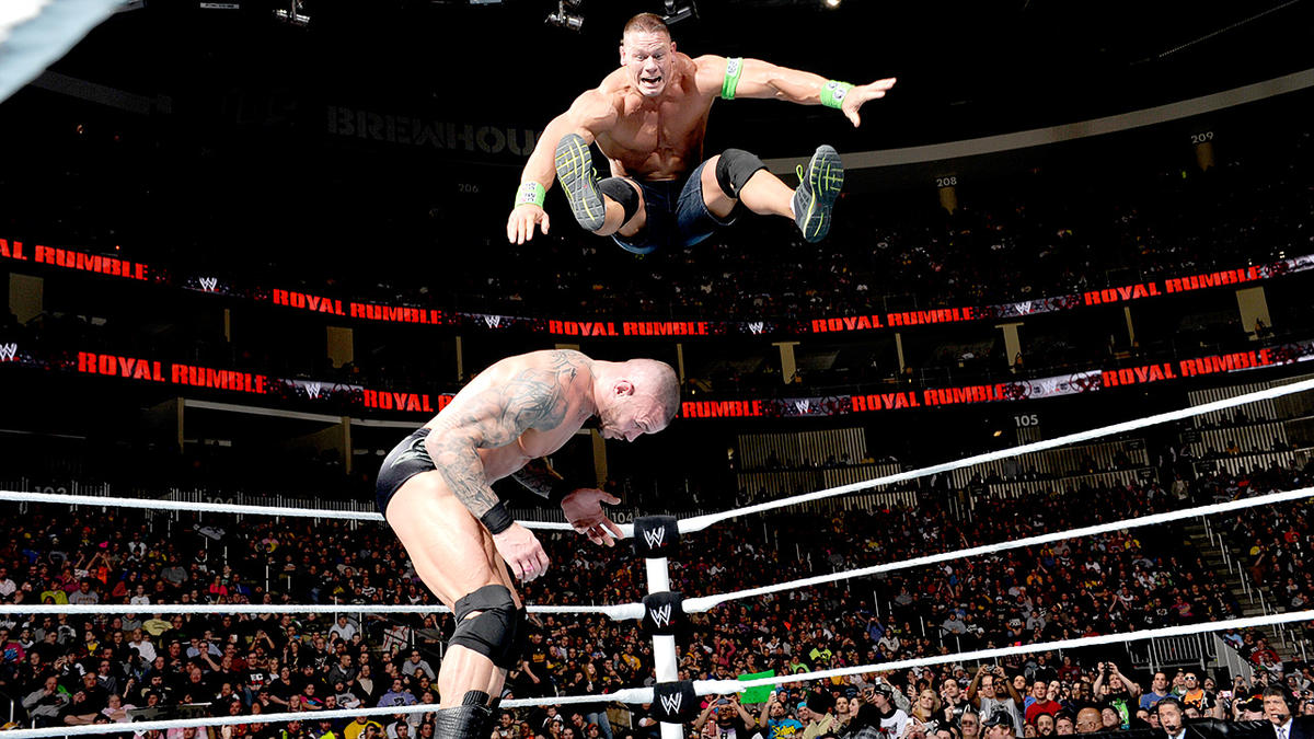 Cena takes flight, pummeling Orton with a top-rope leg drop.