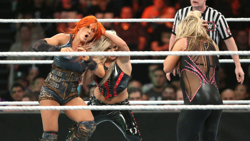 She then throws Becky into The Queen of Harts, allowing Charlotte to defeat Natalya with Natural Selection.