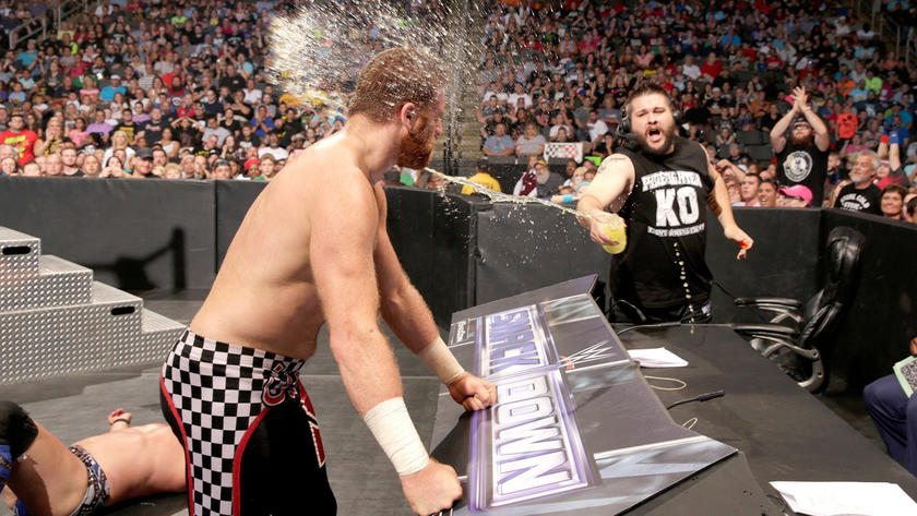 WWE's prizefighter throws his drink in the face of his WWE Battleground opponent, furthering the animosity between them.