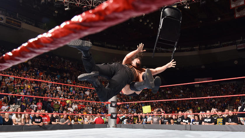 The match ends in a double count-out. Reigns spears Rusev to end a post-match chair assault.
