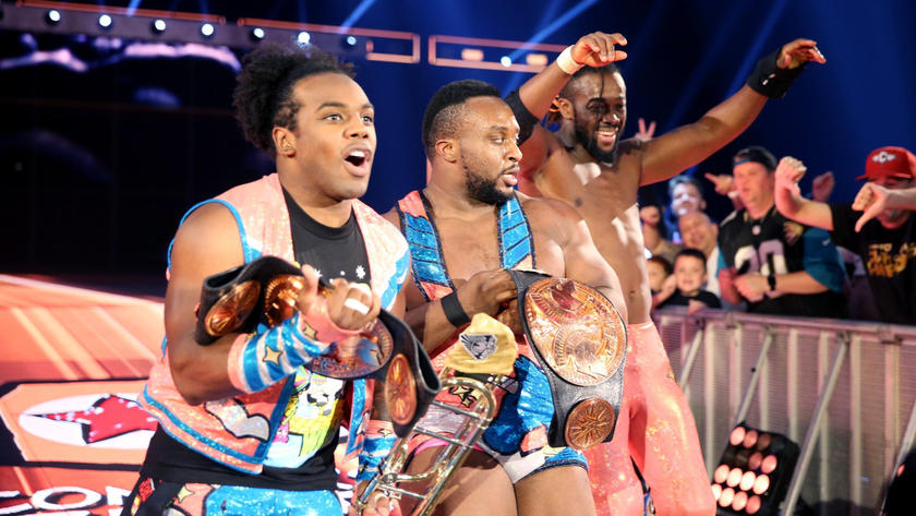 Xavier Woods, Big E and Kingston celebrate their successful title defense.