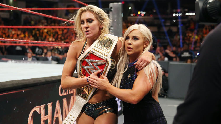 Dana helps the retaining Raw Women's Champion leave ringside.