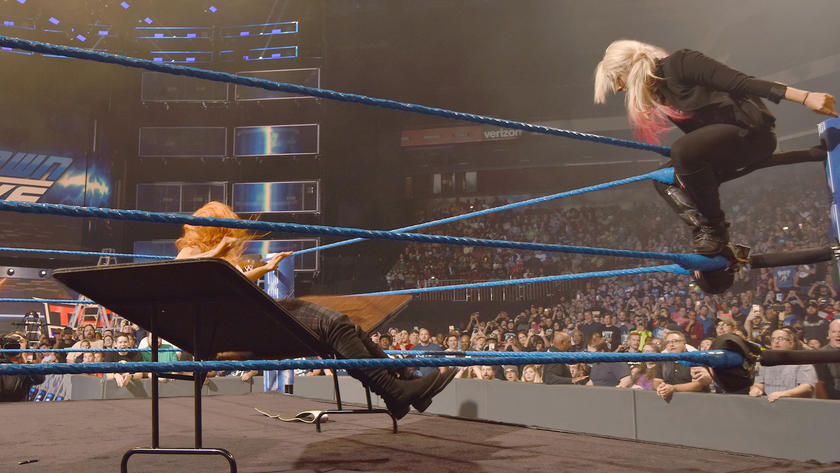 Bliss sends Becky through a table!