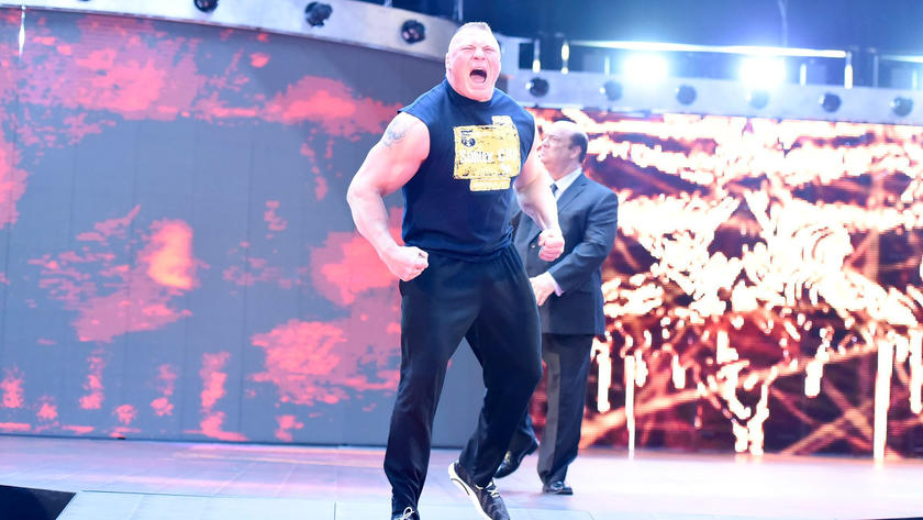 Brock Lesnar storms to the ring with his advocate Paul Heyman.
