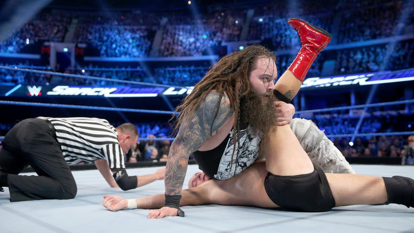Wyatt picks up the tag team victory.