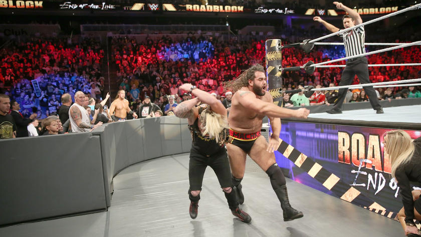 Outside the ring, Rusev clobbers Enzo.