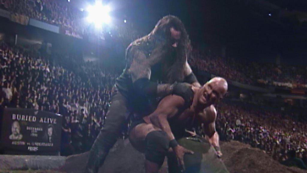 Resultado de imagem para The Undertaker vs. Stone Cold Steve Austin - Rock Bottom