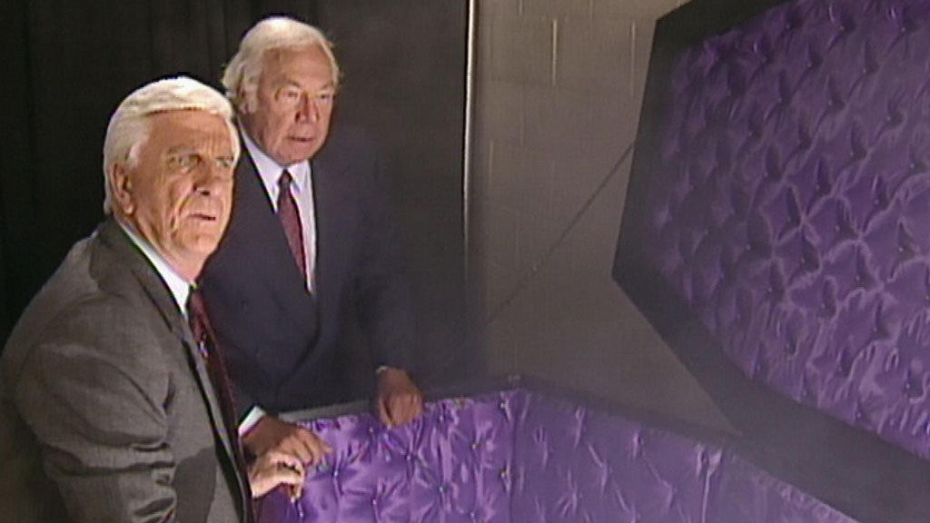 Leslie Nielsen & George Kennedy search for the real Undertaker ...