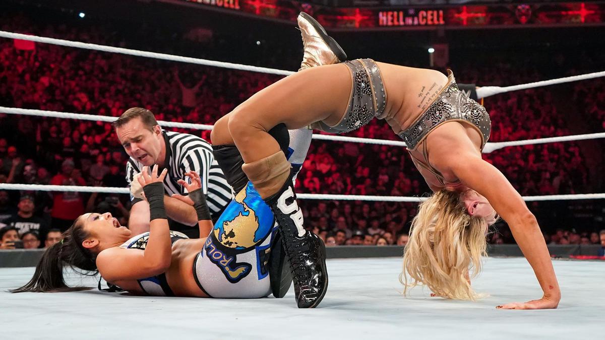 Relive @itsBayleyWWE and @MsCharlotteWWE's #SmackDown Women's Title BATTLE from WWE #HIAC 2019 in its entirety. 👀 👉   Courtesy of @WWENetwork