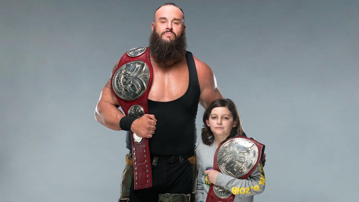Old boy with a y ung wrestler