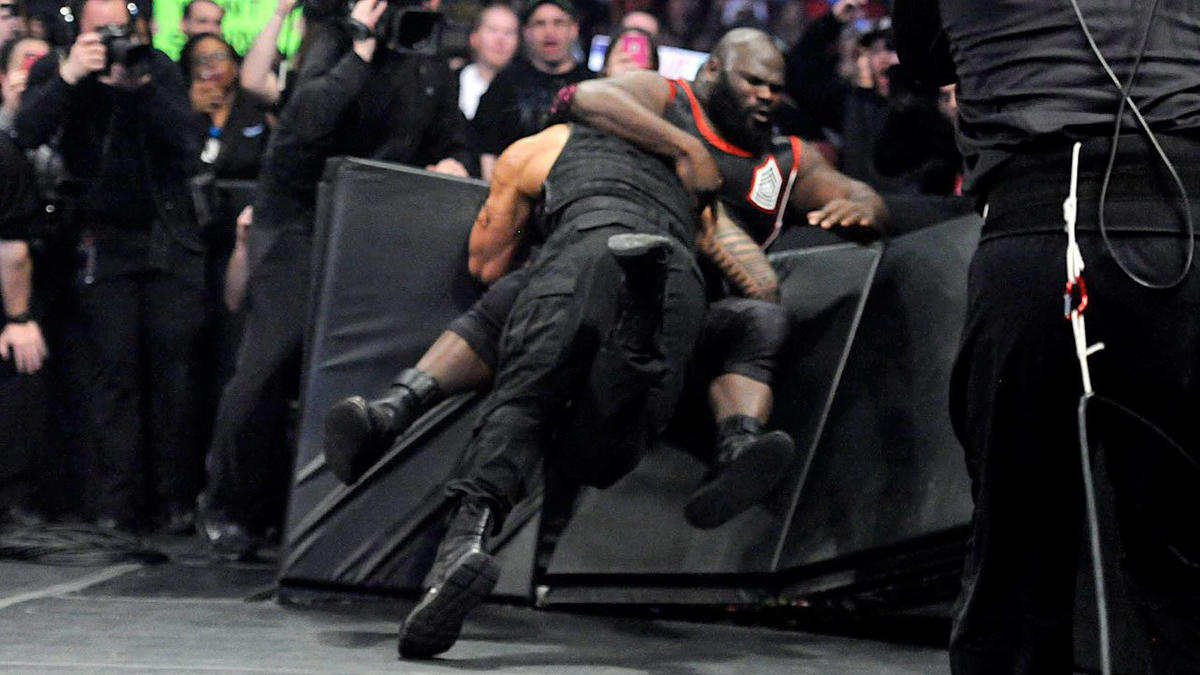Roman Reigns Spears a returning Mark Henry through the barricade: photos | WWE