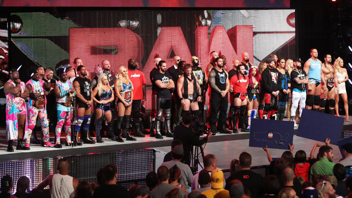 The roster stands on the new stage at Raw as Stephanie McMahon and Mick Foley announce the new WWE Universal Championship