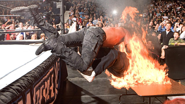 Edge spears Mick Foley through a flaming table: WrestleMania 22 | WWE