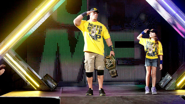 WWE Champion John Cena gives the Superstars for Sandy ...