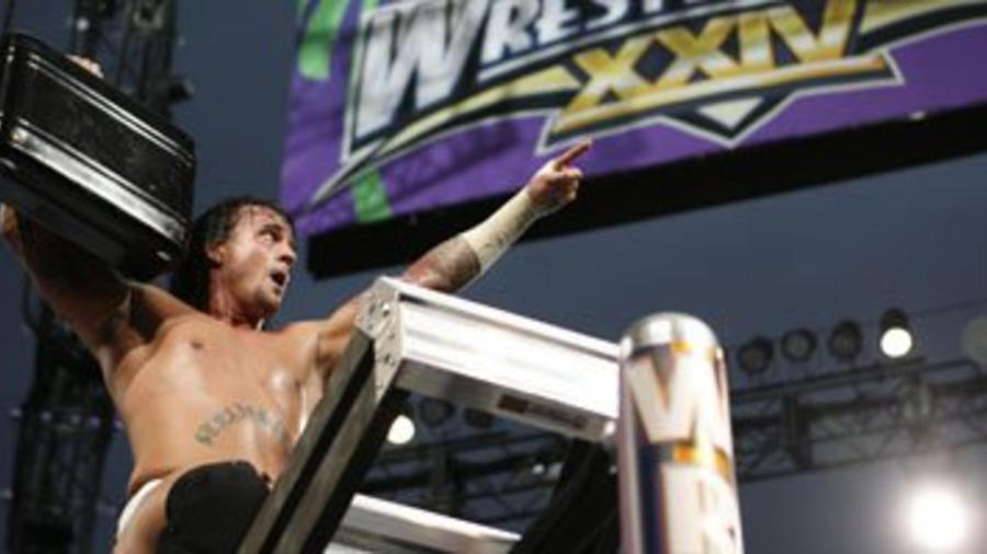 CM Punk wins the Money in the Bank Ladder Match   WWE