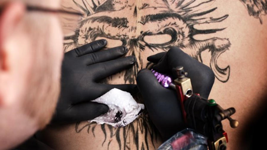 582ce185c The 20 coolest tattoos in WWE history | WWE