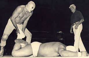 Mexican legend El Santo works over an opponent.