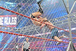 John Cena hits The Miz with an Attitude Adjustment.