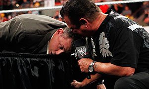 Michael Cole and Jerry Lawler