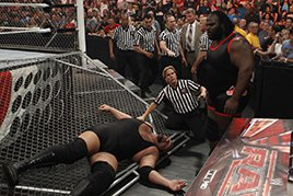 Mark Henry sends Big Show through the steel cage wall