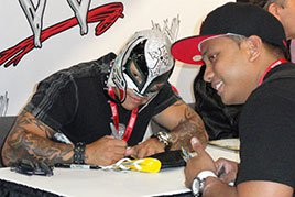 Rey Mysterio signs an autograph at Comic-Con International 2011