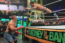 CM Punk flies at John Cena