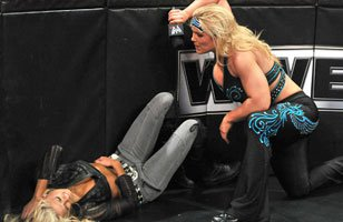 Things between Kelly Kelly and Beth Phoenix get personal on Raw.