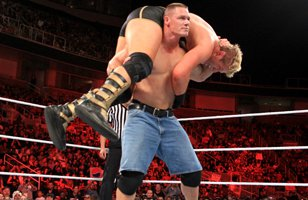 John Cena delivers an Attitude Adjustment to Jack Swagger.