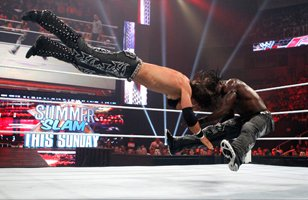 R-Truth drives John Morrison's head into the mat.