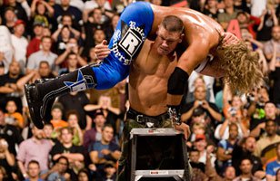 John Cena AA's Edge from atop a ladder at Unforgiven 2006.