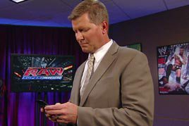 Who is John Laurinaitis texting?