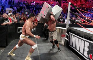 Cena attacks Alberto Del rio with the ring steps at Vengeance.