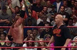 Stone Cold takes over for unconscious official, awards WWE Title to Triple H at Unforgiven 1999.