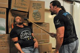 Kevin Nash brutally assaults Triple H with a sledgehammer