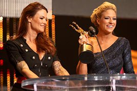 Lita presents Kelly Kelly with the Divalicious Moment of the Year Slammy