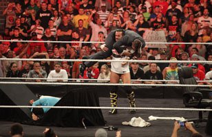 CM Punk ends his TLC contract signing with a bang on Raw SuperShow