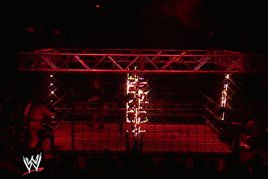 Kane sets a steel cage ablaze on Monday Night Raw